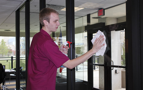Student juggling custodial work and college courses