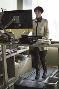 Pam Atkinson (pictured) works daily on a specially crafted treadmill desk.