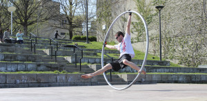 Photo by Maggie Pund A NKU student performs on the Cyr wheel in the amphitheater for the Celebration of Student Creativity and Research. Kirk Wallace, a math and physics major, is known around campus for his creative athletic demonstrations and unusual hobbies