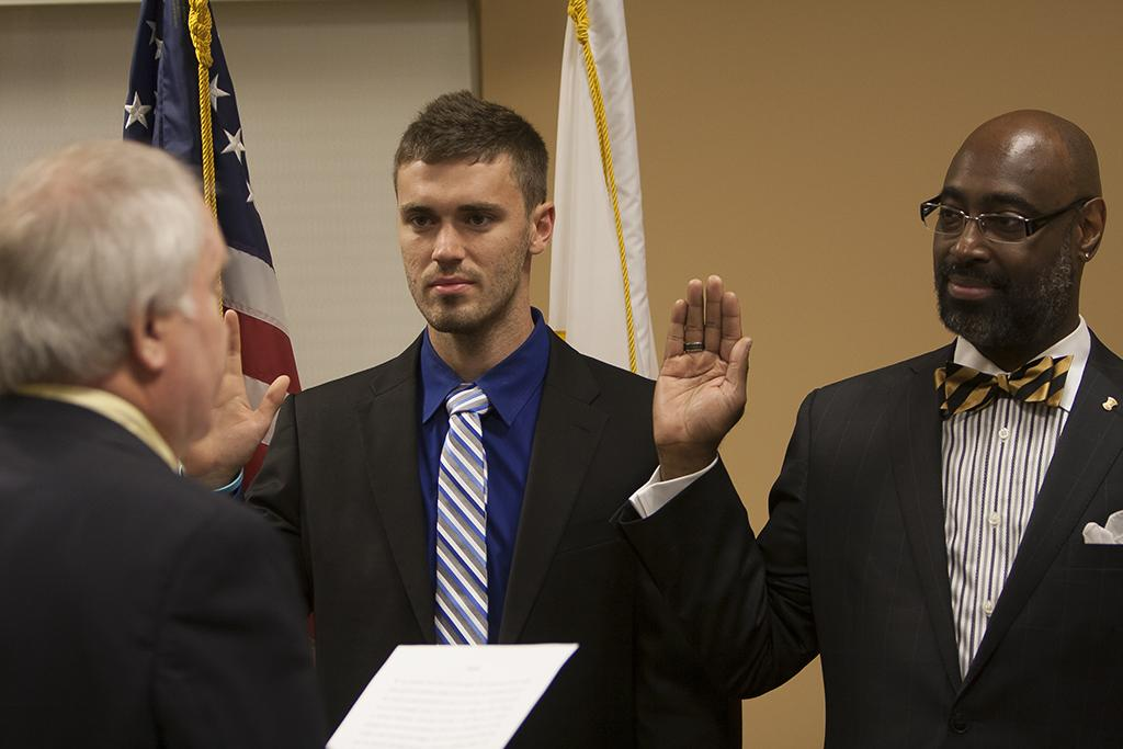 The Northern Kentucky University Board of Regents swore two Regent members in on August 16, 2013 in the Steely Library on NKU Campus. Board of Regents Chair Dennis Repenning (left) swears in Erik Pederson (center) and Andrá Ward (right) at the Board of Regents Meeting.