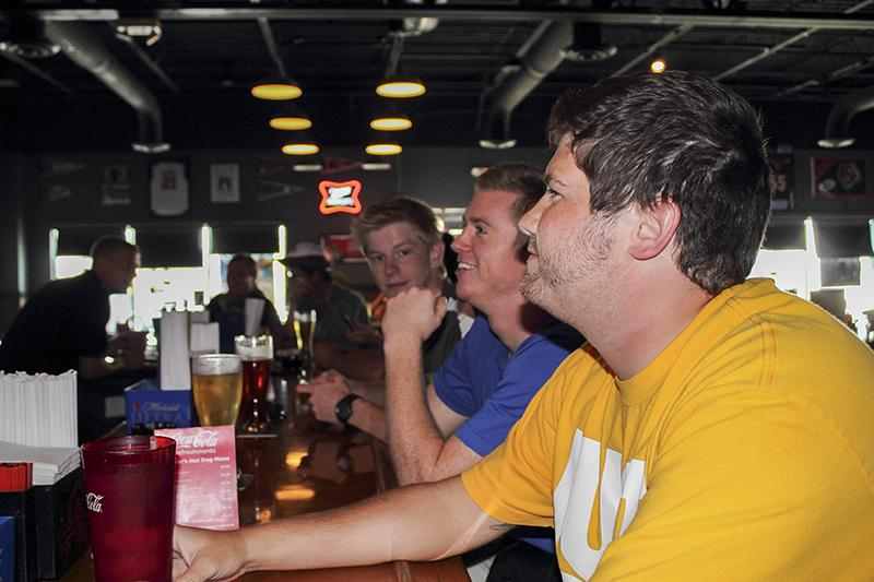 Three Northern Kentucky University Senior Marketing Majors, Matt Crum(left) Jordan Smith (middle) and Jacob Fox (right) enjoying their time at Dunkers Sports Bar & Grill on Tuesday, August 20 of 2013.