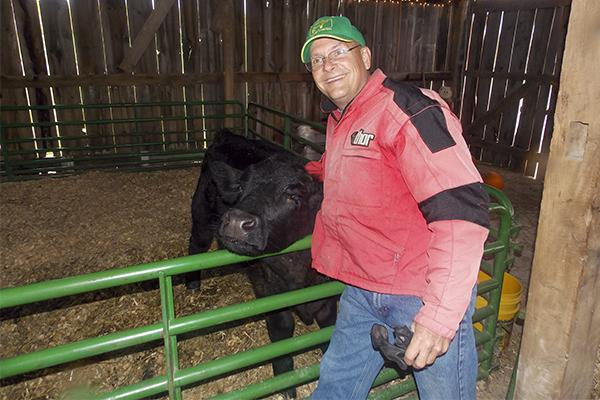 Farm Haven co-owner Stuart Ferguson embraces his calf Caeser. Farm Haven is one of several Northern Kentucky farms offering fall-themed family activities this halloween season.
