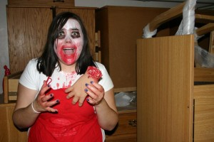 Student volunteer works to scare visitors of Callahan Hall's annual haunted house.