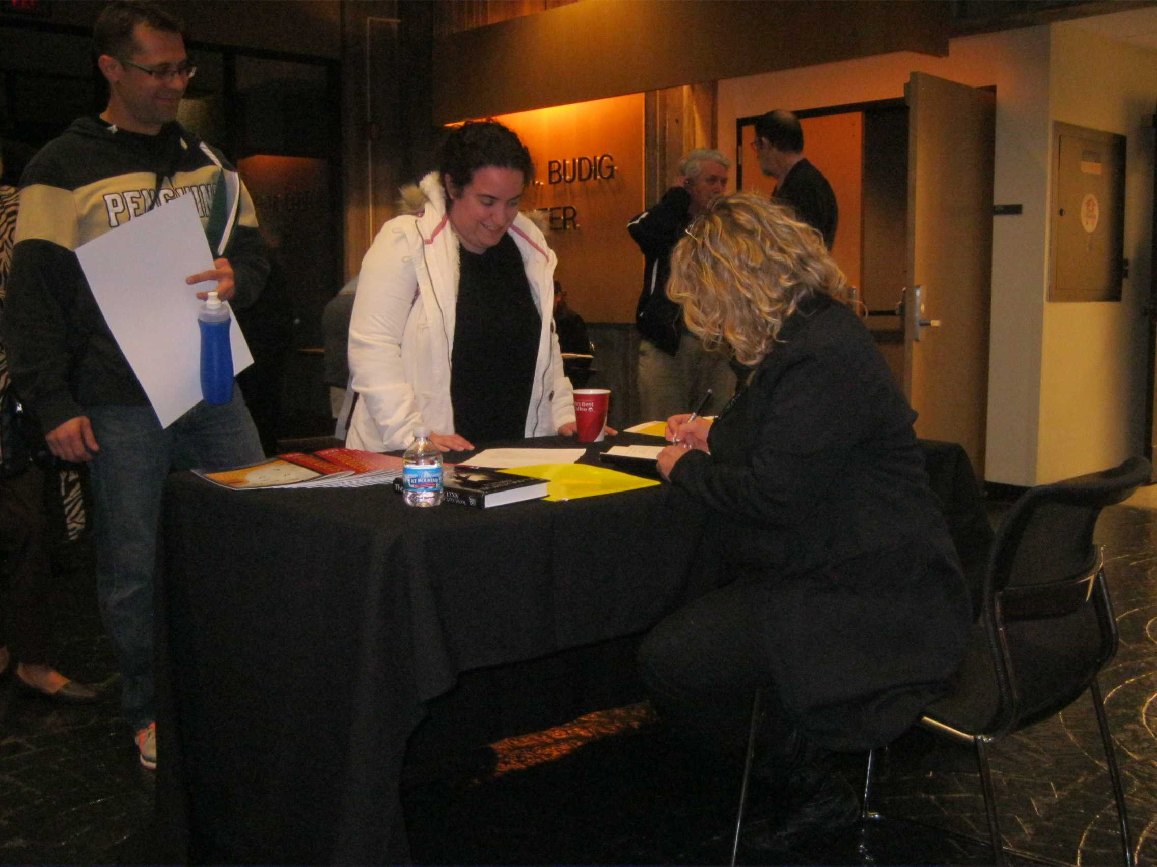 Author Lynn Hightower signs copies of her latest book at Northern Kentucky University. Hightower gave a reading of her latest novel and told the story of studying under a famous Kentucky poet to an audience on in the Otto Budig Theater on Oct. 23.