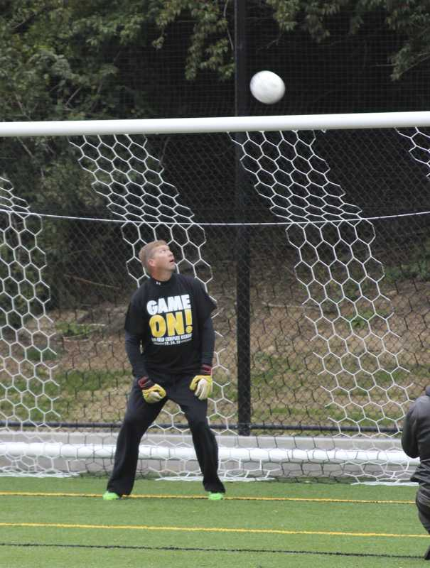 Dean of students Jeffrey Waple played goalie while students took shots.