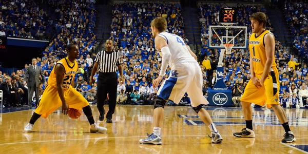 Sophomore+guard+Todd+Johnson+%28far+left%29+dribbles+between+his+legs+while+running+point+guard+for+the+Norse.+