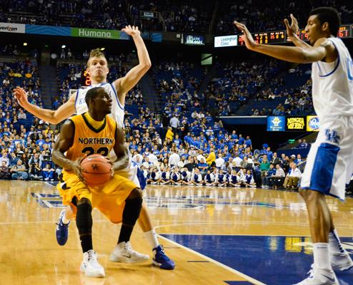 NKU+sophomore+guard+Todd+Johnson+looking+to+pass+the+ball+while+avoiding+UK%27s+Jarrod+Polson+and+Marcus+Lee.