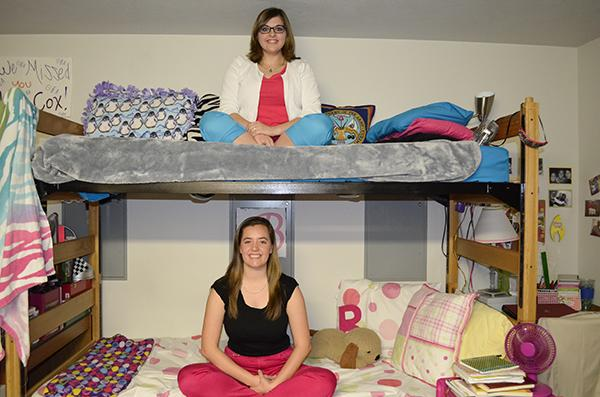 Katie Cox (top) and Brandi Cunningham (bottom) sit in their Kentucky Hall dorm room. The two friends have harnessed their differences to help each other succeed throughout college, like serving on NKU's Student Government Association.