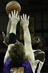 Jalen Billups (#21) shoots the ball in the first half, finishing with 11 points and 5 rebounds.  The Norse lost 74-61 to Morehead State on Tuesday, November 19, 2013 at the Bank of Kentucky Center in Highland Heights, KY.