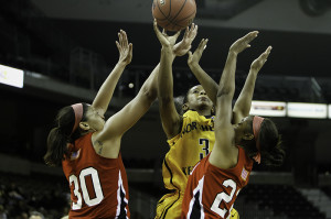 NKU guard Lauren White (#3) goes up for a layup against WKU Saturday night. Western Kentucky University defeated NKU 74-64 Saturday, November 23, 2013 at the Bank of Kentucky Center.