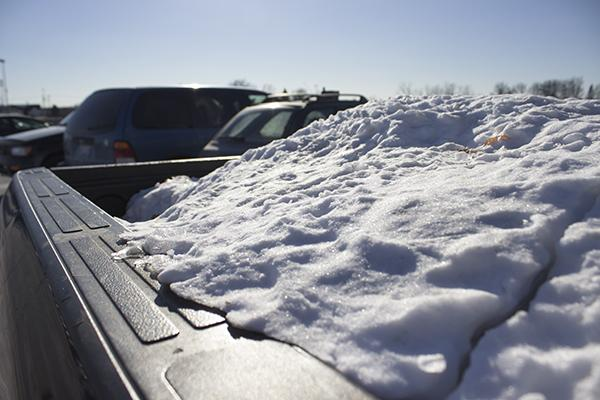 The trunk of a student's truck on campus is filled with snow and ice after the adverse winter weather.