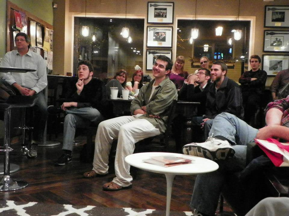 A group of students, faculty, staff and more gather at Mount Adam's Bow Tie Cafe as a part of Loch Norse Magazine's monthly Open Mic Night's.