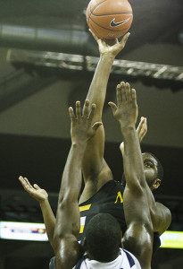 NKU's Jalen Billups shoots the ball, finishing with a double double with 12 points and 12 rebounds in NKU's loss to FGCU Thursday night. NKU lost to Florida Gulf Coast 64-50 Thursday, February 6, 2014 at The Bank of Kentucky Center.
