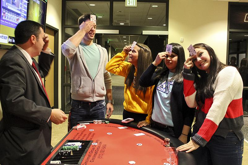 Students participate in a card game at Casino Night, part of APB's Student Union Festival.
