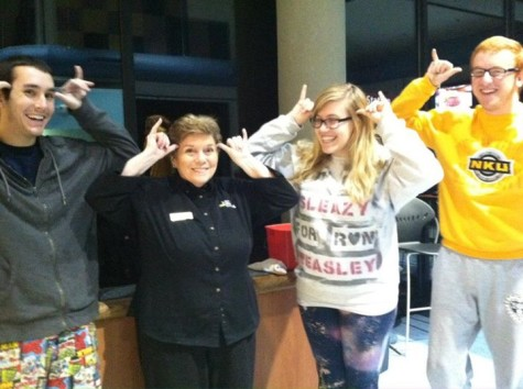 From left to right Matt Hepner, Mary Pat, Emily Ries, and Taylor Dwyer throw their Norse Up in Norse Commons.