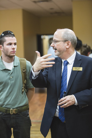 College of Informatics Dean Kevin Kirby brainstorms new ideas with students.