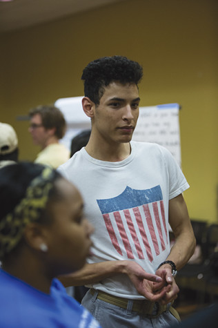 Student Marcel Hughes gives his suggestions about the university's dorms to the Student Enrollment  committee member.
