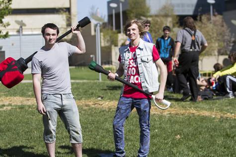 Ryan Kellam and Jared Koshiol prepare for a Dagorhir battle.