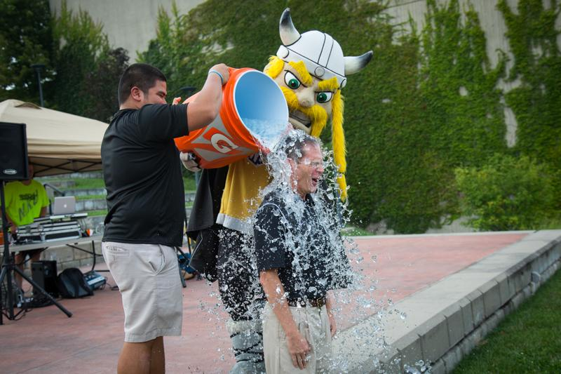 SGA President John Jose and Victor E. Viking dump ice water on President Mearns.