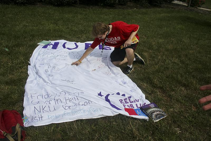 Students could write on the Relay for Life banner if someone they knew was affected by cancer or just to write words of encouragement. File photo, Aug. 26, 2014.