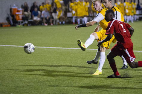 NKU men's soccer player, Ronald Moss, scores NKU's only goal in the match vs University of Cincinnati that finished in a tie. NKU hosted University of Cincinnati on Friday, August 29, 2014 at the NKU Soccer Stadium, drawing a tie at 1-1.