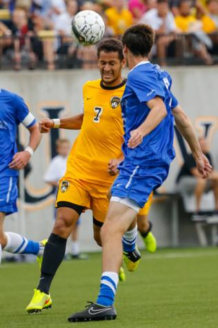 NKU Men's Soccer midfielder Alwin Komolong heads the ball towards the goal in the first half of NKU's home opener game vs UK. NKU tied University of Kentucky 0-0 Sunday, August 18, 2014 at NKU's Soccer Complex.