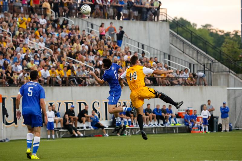 NKU+Men%27s+Soccer+forward+Caleb+Eastham+heads+the+ball+towards+the+goal+in+the+first+half+of+NKU%27s+home+opener+game+vs+UK.+NKU+tied+University+of+Kentucky+0-0+Sunday%2C+August+18%2C+2014+at+NKU%27s+Soccer+Complex.