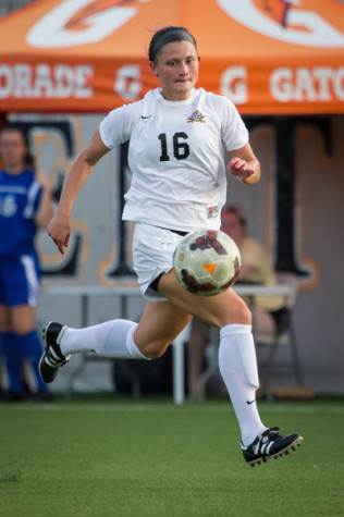NKU women's soccer player, Kelsey Laumann dribbles down the field during NKU's 4-0 win against Eastern Illinois University. NKU defeated Eastern Illinois University 4-0 after the game was called due to lightning in the area.