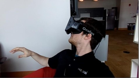 Branden Middendorf tests out the Oculus Rift.