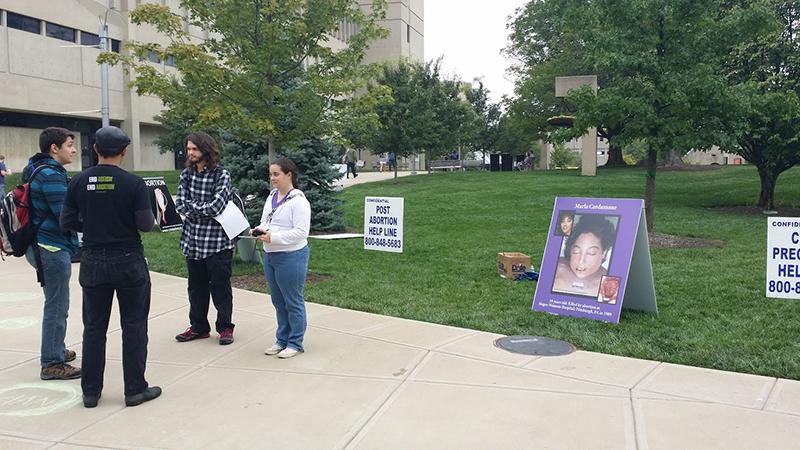 Students+discuss+the+rights+and+wrongs+of+abortion+among+graphic+pictures+placed+outside+the+Student+Union.+