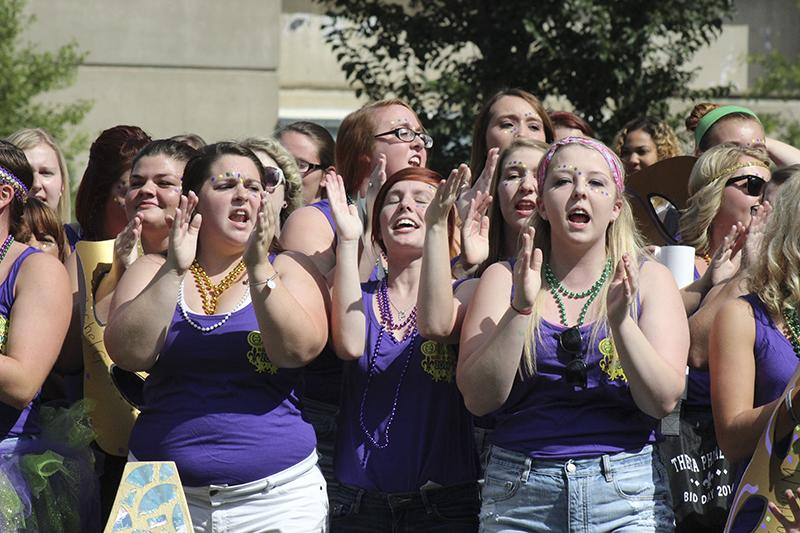 Bid+day+participatns+chant+and+yell+together.+