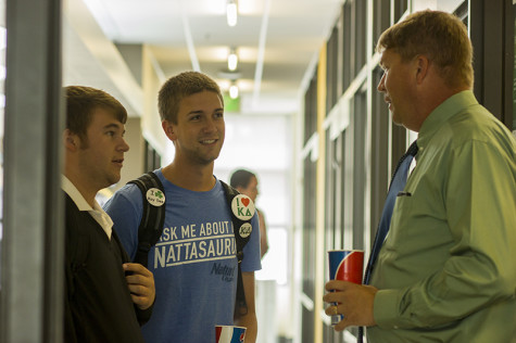 Dean Waple interacts with students Karl Bragg and Matt Kriege during his lunch break in the Student Union.