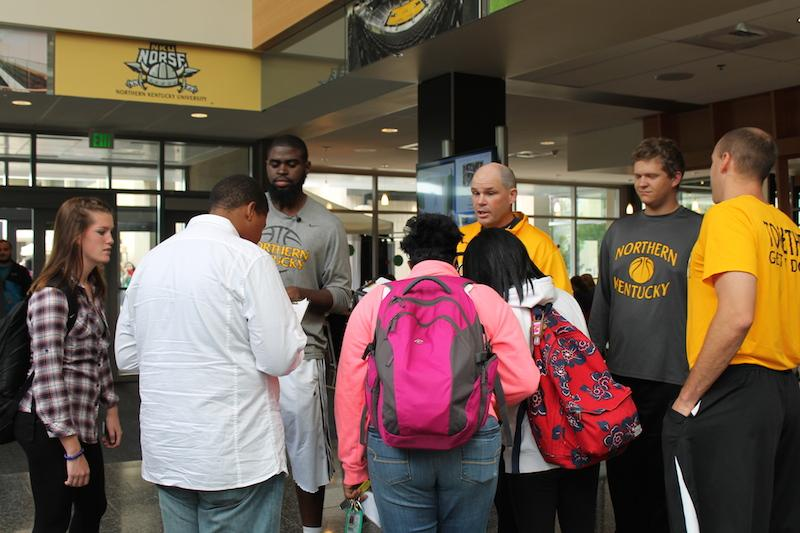 Jalen Billups and men's basketball Head Coach Dave Bezold try to persuade a group of people on who to side with.