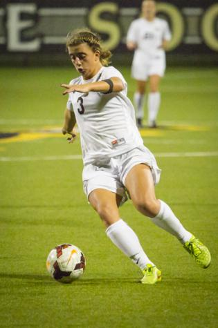 NKU forward Macy Hamblin dribbles the ball at the goal in NKU's 2-1 overtime loss Wednesday night. NKU lost in overtime 2-1 against Butler University at NKU Soccer Stadium on Wednesday, Sept. 17, 2014.
