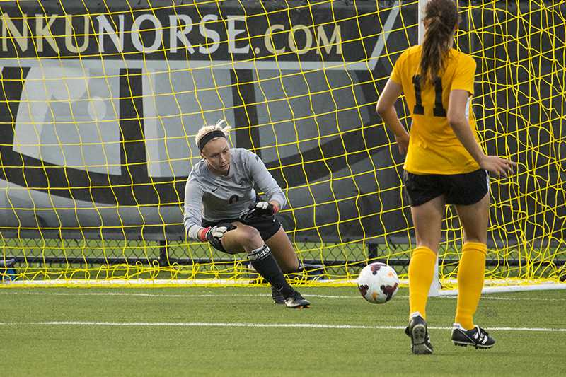 NKU goalkeeper Brooke Schocker dives for the save during NKU's 1-1 tie against Xavier. The Norse tied Xavier 1-1 at the NKU Soccer Stadium on Sept. 9, 2014.