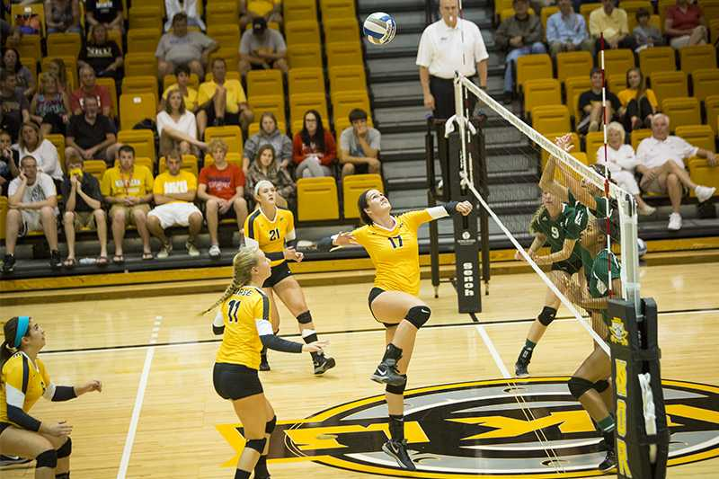 NKU middle hitter Jenna Ruble jumps to hit the ball over the net during NKU's 3-0 loss to Eastern Michigan. NKU lost to Eastern Michigan on Saturday, Sept. 6, 2014 at Regent Hall in the inaugural Northern Kentucky Volleyball Invitational and finished 2-1 in the tournament.