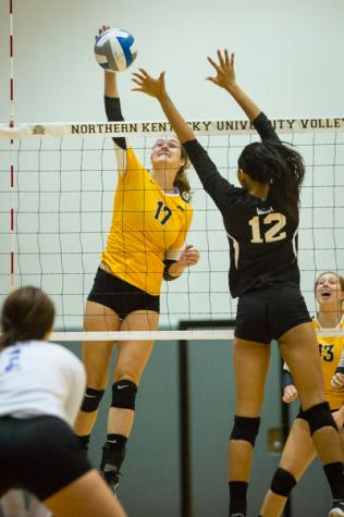 NKU's Jenna Ruble spikes the ball over the net in NKU's  3-2 win over Evansville. The Norse beat Evansville 3-2 in Regents Hall on Sept. 16, 2014.