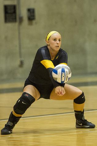 NKU libero Mel Stewart hits the ball during NKU's 3-0 loss to Eastern Michigan. NKU lost to Eastern Michigan on Saturday, Sept. 6, 2014 at Regent Hall in the inaugural Northern Kentucky Volleyball Invitational and finished 2-1 in the tournament.