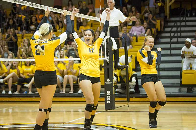 NKU's Jenna Ruble (17), Jayden Julian  (21) and Taylor Snyder  (11) celebrate a point during the Norse's 3-0 win over Samford University. Northern Kentucky University won 3-0 against Samford University in the inaugural Northern Kentucky Volleyball Invitational on Friday, Sept. 5, 2014 in Regents Hall in Highland Heights, Kentucky.