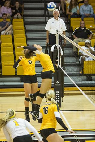 NKU's Keely Creamer (14), spikes the ball during the Norse's 3-0 win win over Samford University. Northern Kentucky University won 3-0 against Samford University in the inaugural Northern Kentucky Volleyball Invitational on Friday, Sept. 5, 2014 in Regents Hall in Highland Heights, Kentucky.