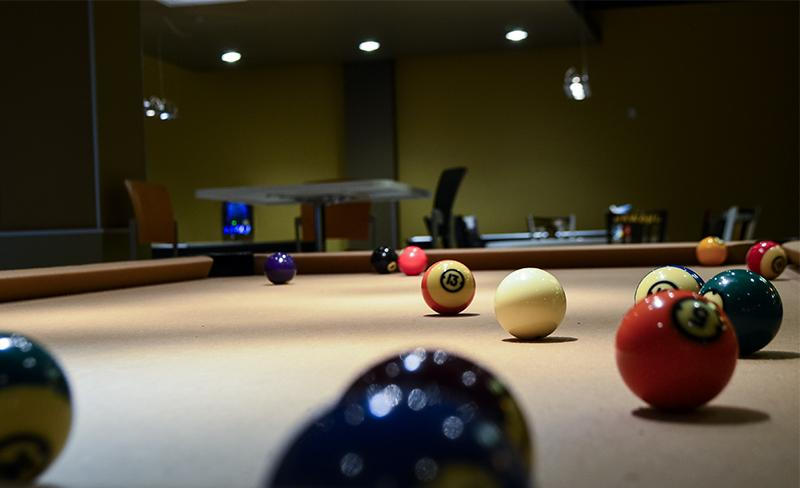 A pool table in the game room. While pool is the most popular game, students have the choice to play a variety of Wii, Playstation 3 and Xbox 360 too.