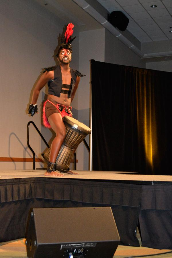 Alexander Cameron plays the conga in costume during the drag show. Audience members attempted to throw dollar bills onto the conga in between beats.