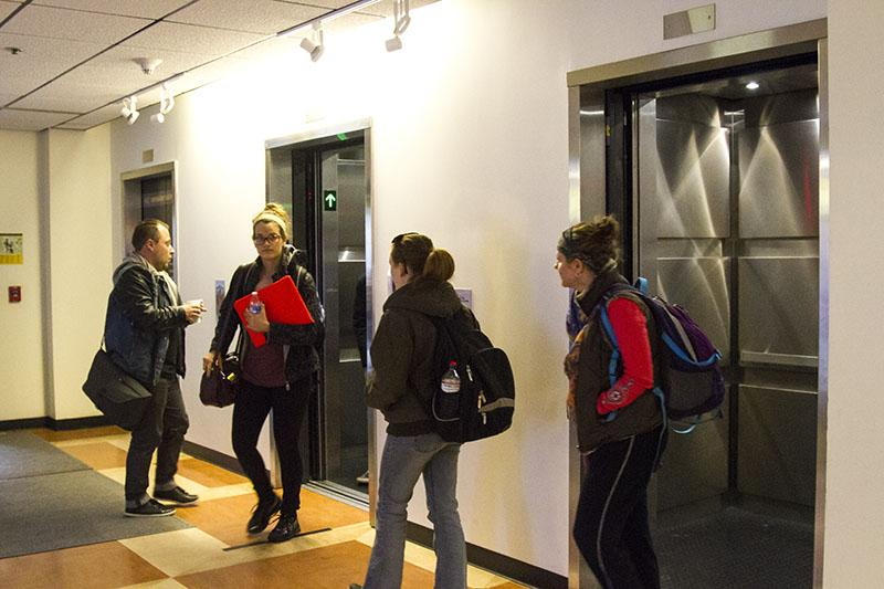 Students+enter+and+exit+the+renovated+Landrum+elevators.+The+elevators+were+originally+considered+unsafe.+