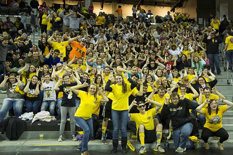 Students+throw+up+their+Norse+during+the+game.+