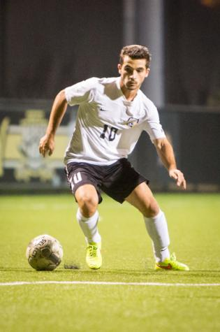 NKU midfielder Diego Martinez dribbles the ball towards the goal in NKU's 1-0 victory over Eastern Illinois. NKU defeated Eastern Illinois 1-0 at NKU Soccer Stadium on Wednesday, Oct. 29, 2014.