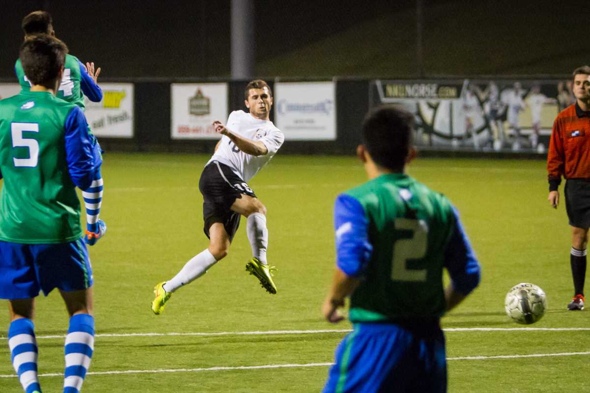 NKU's Cian McDonald shoots the ball in the second half for NKU's lone goal during NKU's 3-1 loss to FGCU. The Norse lost 3-1 to Florida Gulf Coast University at NKU Soccer Stadium on Saturday, Oct. 11, 2014.