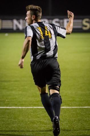 NKU player Caleb Eastham celebrates after scoring a goal in the second half of NKU's 2-0 win over UNC Asheville. NKU defeated UNC Asheville 2-0 on Oct. 22, 2014 at NKU Soccer Stadium.