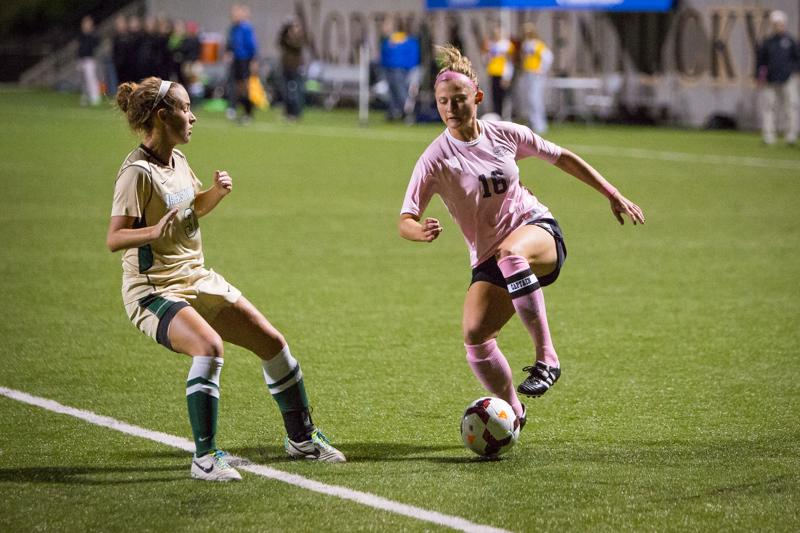 NKU+player+Kelsey+Laumann+dribbles+against+a+defender+in+NKU%27s+1-0+loss+to+Jacksonville+Friday+night.+NKU+lost+to+Jacksonville+1-0+at+NKU+Soccer+Stadium+on+Oct.+3%2C+2014.