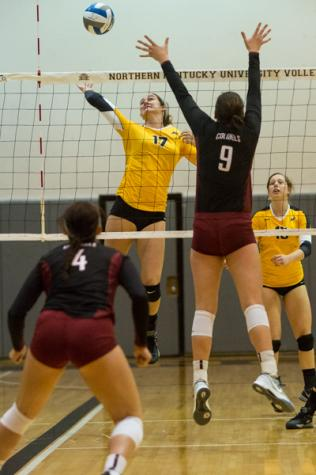 NKU's Jenna Ruble spikes the ball against an EKU player during the second set of NKU's 3-1 victory over Eastern Kentucky University. NKU defeated EKU 3-1 at Regents Hall on Northern Kentucky Campus on Oct. 28, 2014.