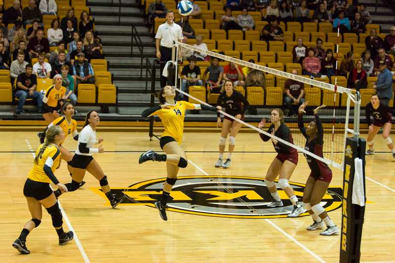 NKU's Keely Creamer goes up to spike the ball over the net. She and the Norse will look to start the season strong tonight vs. Indiana